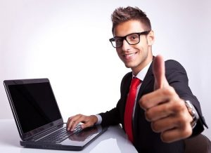 Guy on computer with a thumbs up